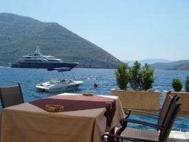 Hotel Conte in Perast has tables overlooking the Bay with a view of the Islands of Our Lady and St George.